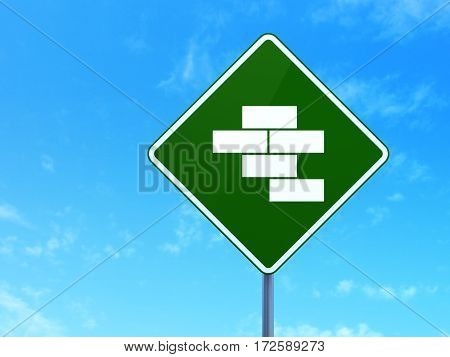 Construction concept: Bricks on green road highway sign, clear blue sky background, 3D rendering