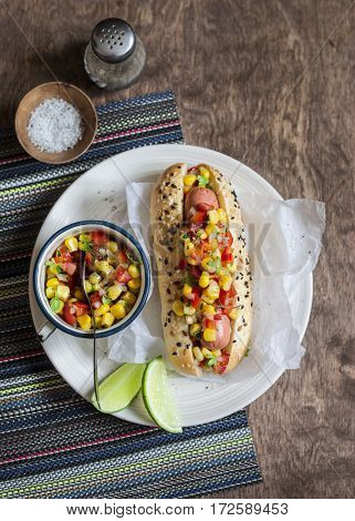 Mexican street style hot dog on wooden background top view.