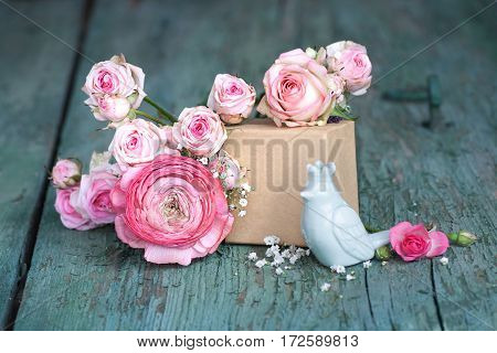 Still life in pink on an old shabby wooden table for a mothers day card