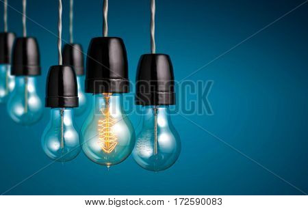 Group Of Vintage Bulb Lights With One Antique Light Bulb Turn On , Creative Idea And Leadership Conc