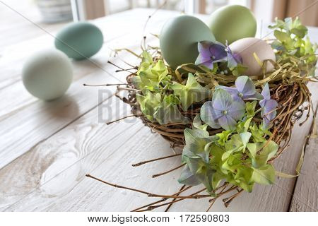 Still life for easter on a white wooden table in a room