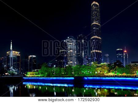 GUANGZHOU CHINA - OCTOBER 25 2015: Night view of the Pearl River and modern buildings at the Zhujiang New Town in Guangzhou China