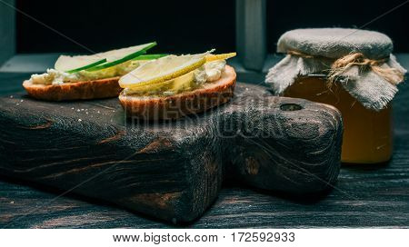 Honey and sandwiches of bran bread with cottage cheese and fresh fruit toppings