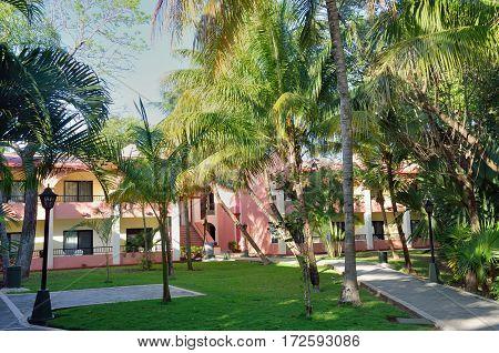 Playa del Carmen Mexico - January 19 2017: Carribean resort hotel partly hidden by trees