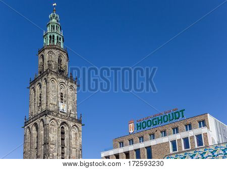 GRONINGEN, NETHERLANDS - FEBRUARY 15, 2017: Martini tower and Vindicat building in Groningen, Holland