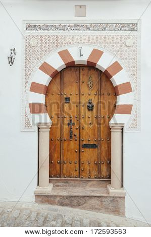 arabic door with geometric arch and muslim decoration