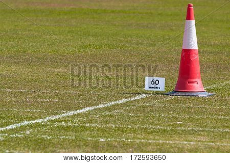 60 meter distant sign for school track and field running on grassy field