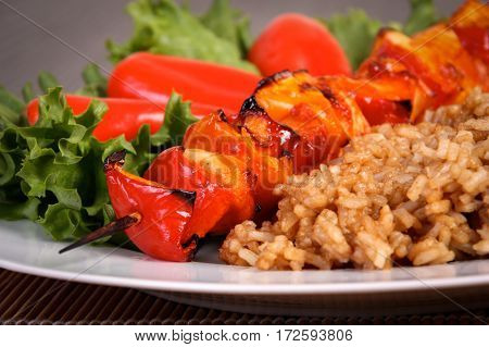 chicken kebeb skewer plate with brown rice and salad
