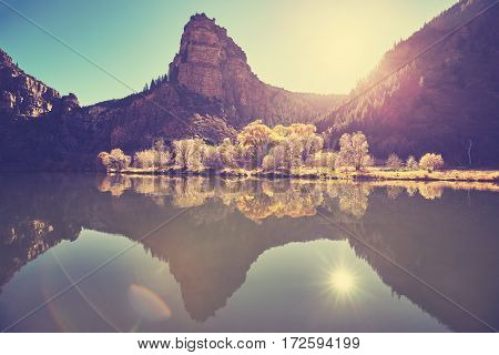 Beautiful Mountain Lake At Sunrise With Lens Flare Effect.
