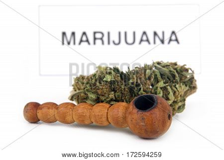 medical marijuana drug bud and pipe white background