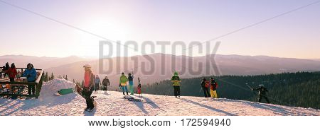 BUKOVEL UKRAINE -31 January 2017: Skiers and snowboarders on top of the mountain are eating relaxing taking pictures and making selfie