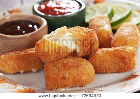 Breaded mozzarella cheese sticks served with tomato sauce