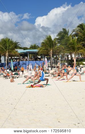 Playa del Carmen Mexico - January 28 2017: Holidaymakers in keep fit exercise class on caribbean beach