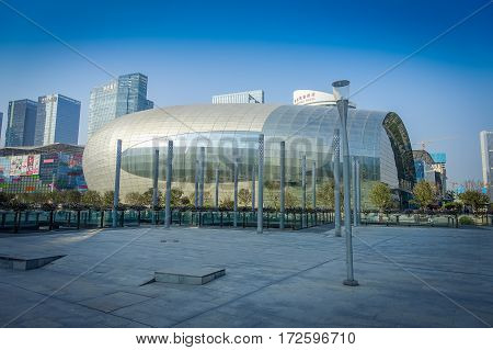 SHENZEN, CHINA - 29 JANUARY, 2017: Inner city streets and sorroundings of Nan Shan neighborhood, spectacular cultural arts building covered in shiny metal surface, totally blue skies.