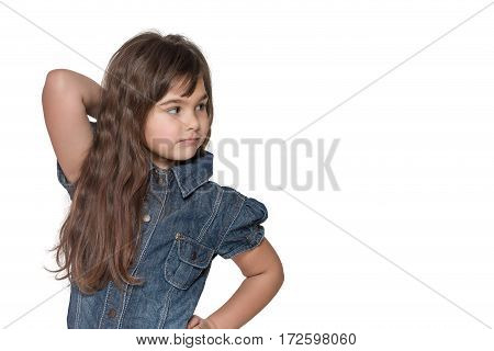 Portrait in half of the body of long haired brunette little girl isolated on the white background. Girl is looking sideways into the free place ready for your text.