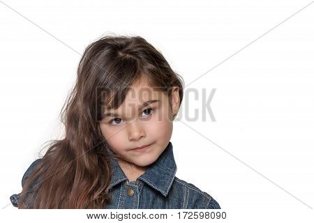 Portrait of long haired brunette little girl isolated on the white background. Girl is looking at the camera.