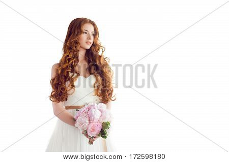 Young beautiful caucasian bride with bouquet of wedding flowers isolated on white background.
