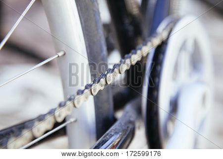 close up of a bike chain isolated on the street