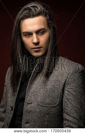 fashionable man in jacketon color background portrait