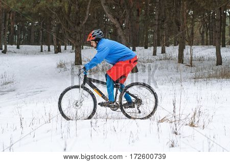 Cyclist On The Mountain Bike, Extreme Winter Riding In The Forest.