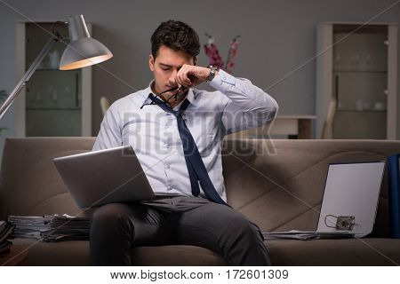Businessman workaholic working late at home