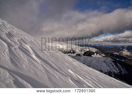Winter landscape of mountains. Snow-bound mountain landscape. Mountain landscape.