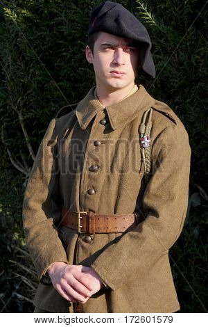 a french soldier in 1940's uniform outdoor