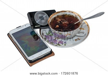 Smartphone camera and a cup of tea on a white background closeup