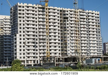 House under construction with white silicate blocks at a construction site