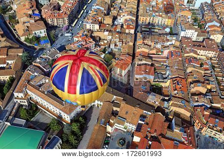 Hot air balloon flight over the city Vic. Spain