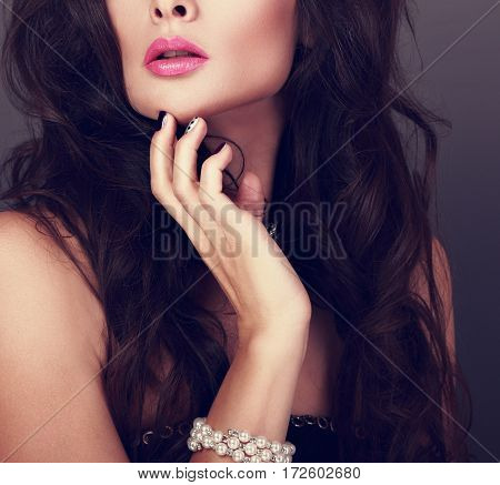 Beautiful Woman With Pink Lipstick, Manicured Nails Near The Face And Luxury Pearl Bangle On The Han