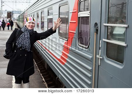Girl Says Goodbye Departing Train And Waves By Hand After Him
