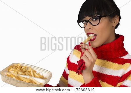 Attractive young woman is eating french fries isolated on white background.