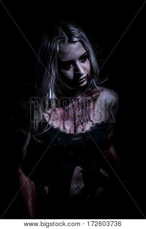 Walking dead woman with blood over black background