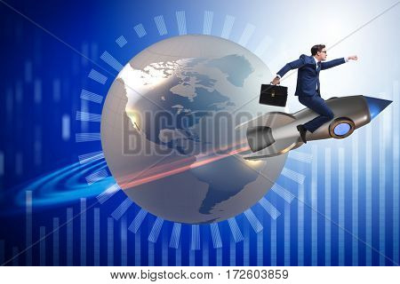 Businessman on the rocket in global business concept