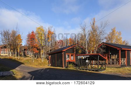 LAPLAND, SWEDEN ON SEPTEMBER 21. Modern, wooden cabin, lodge close to the Hotel Fjallet on September 21, 2016 in Lapland, Sweden. Sunny morning in the autumn, fall. Editorial use.