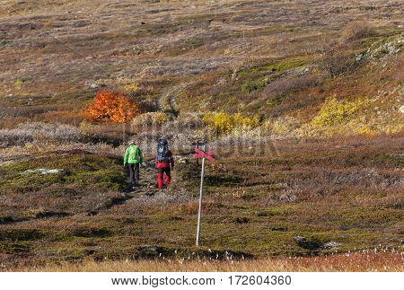 BJORKLIDEN, SWEDEN ON 21 SEPTEMBER. View of a mountain trail, track on September 21, 2016 in Bjorkliden, Sweden. Unidentified couple on is way up the track. Editorial use.