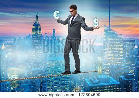 Businessman balancing between choosing dollar and euro