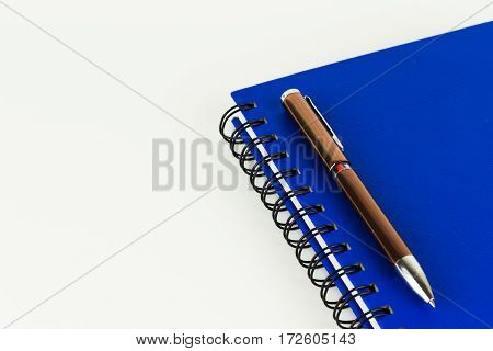 Diary Book and pen on white background.