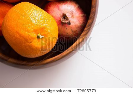 Fresh ripe oranges in wooden vase. Top view with copy space