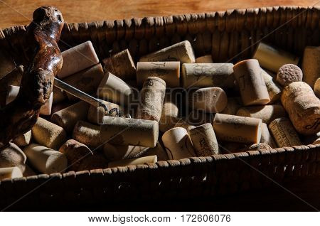wine corks in a old basket bread on rosewood timber with copy space