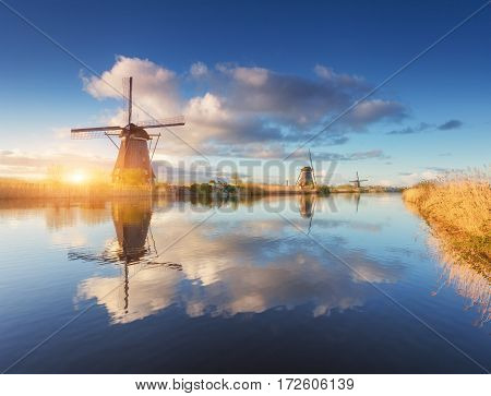 Rustic Landscape With Amazing Dutch Windmills At Sunrise