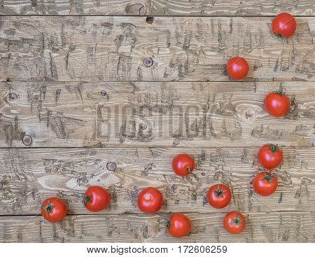Fresh cherry tomatoes scattered on a rustic table. The concept of healthy homemade food.