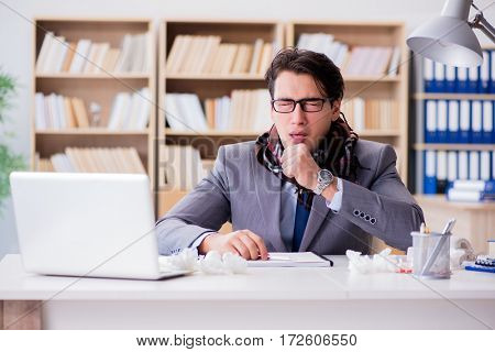 Sick businessman suffering from illness in the office