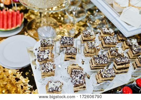 Different Swets And Cakes At Wedding Reception.