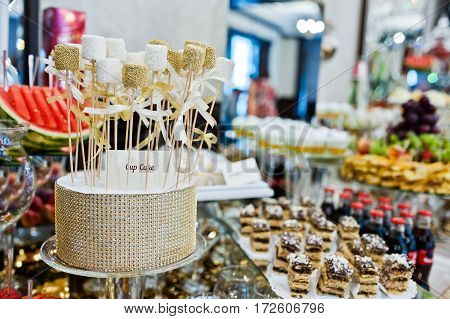 Different Swets And Cup Cakes At Wedding Reception.