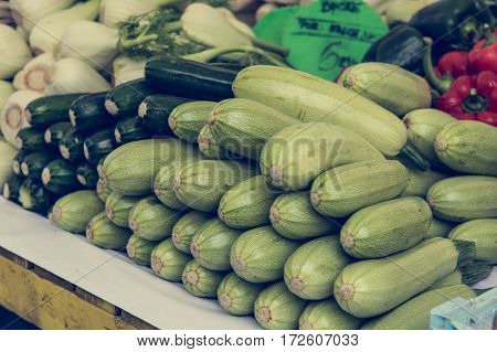 Closeup of garden vegetables. Outdoor market selling domestic products.