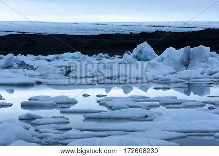 Icebergs in Fjallsarlon glacial lagoon. Vatnajokull National Park, southeast Iceland, Europe.