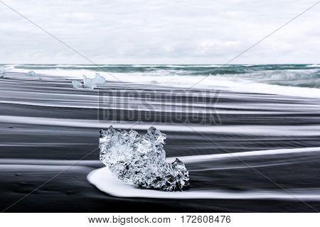 Iceberg pieces on Diamond beach, near Jokulsarlon lagoon, Iceland.