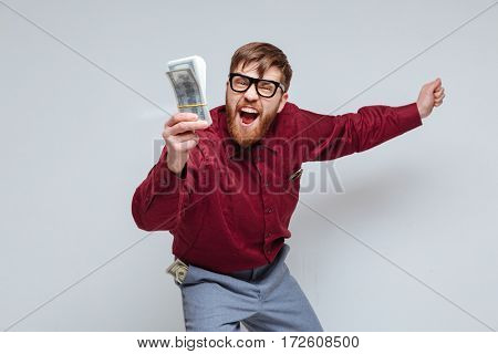 So Happy Male nerd with money in hand. Isolated gray background